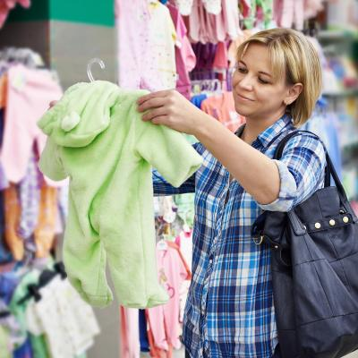 woman chooses rompers in store